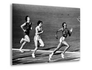 US Runner Wilma Rudolph Winning Women's 100 Meter Race at Olympics by Mark Kauffman