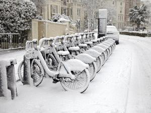 Rows of Hire Bikes in Snow, Notting Hill, London, England, United Kingdom, Europe by Mark Mawson
