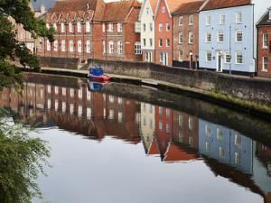 Quayside Buildings Reflected in the River Wensum, Norwich, Norfolk, England, United Kingdom, Europe by Mark Sunderland