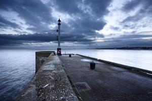 Sea Wall and Harbour Light at Bridlington, East Riding of Yorkshire, England, United Kingdom by Mark Sunderland