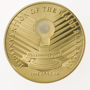 An LED bulb that lights up embedded in a coin from Niue Island by Mark Thiessen
