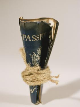 An Old Passport is Bound in Twine by Mark Thiessen