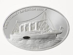 Embedded coal from the Titanic in a coin from Liberia by Mark Thiessen