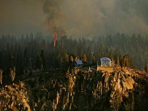 Firefighters cover the Scott Mountain lookout in heat-reflecting wrap by Mark Thiessen