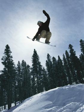 Snowboarder in Flight, Colorado by Mark Thiessen