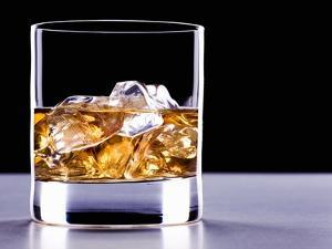 A Glass of Whisky with Ice Cubes by Mark Vogel