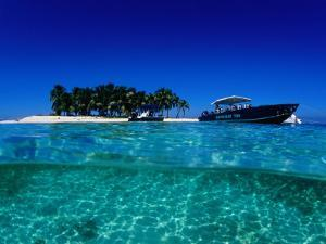 Dive Boats off Island, South Water Caye, Stann Creek, Belize by Mark Webster