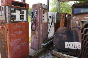 Rusty Gas Pumps And Car by Mark Williamson