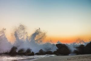 Waves Crashing on Rocky Beach at Sunset by Markus Henttonen