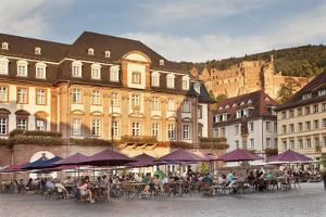Restaurant and street cafe at the market square, town hall and castle, Heidelberg, Germany by Markus Lange