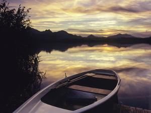 Rowing Boat on Hopfensee Lake at Sunset, Near Fussen, Allgau, Bavaria, Germany, Europe by Markus Lange
