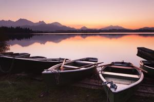 Rowing Boats on Hopfensee Lake at Sunset by Markus Lange