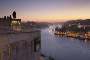 View from Vila Nova de Gaia View over Douro River at sunset to Ribeira District, UNESCO World Herit by Markus Lange