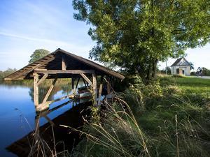 Boat Garage in the Schwaigfurt Pond Bad Schussenried, Baden-WŸrttemberg, Germany by Markus Leser
