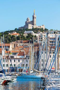 Marseille, Provence-Alpes-Cote d'Azur, France. View across Vieux-Port, the Old Port, to the 19th...