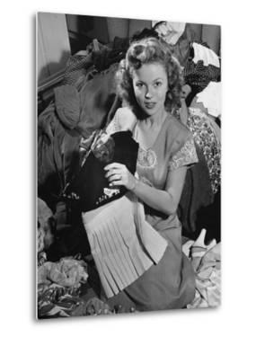 Actress Shirley Temple, Gathering Her Unwanted Clothes Together to Donate to a Clothing Drive by Martha Holmes