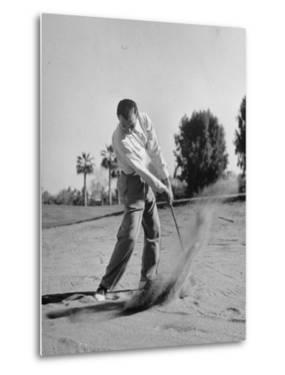Golfer Ben Hogan Playing Golf in Sandtrap by Martha Holmes