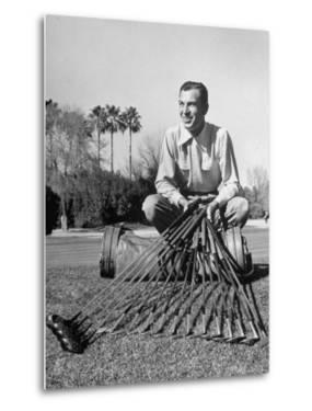 Golfer Ben Hogan with Golf Clubs by Martha Holmes