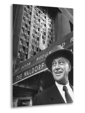 Hotel Magnate Conrad N. Hilton in Front of the Waldorf Astoria Hotel by Martha Holmes