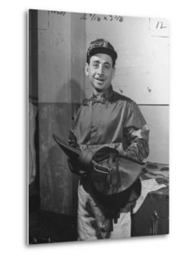 Jockey Johnny Longden Smiling and Holding Saddle by Martha Holmes