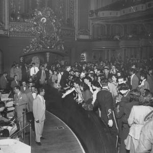 Singer Billy Eckstine in Front of Orchestra and the Members of His Band at the Paramount Theater by Martha Holmes