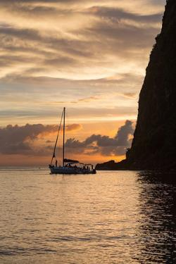 Boat moored at the base of Petit Piton near Sugar Beach at dusk, St. Lucia, Windward Islands, West by Martin Child