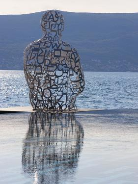 Sculpture of a Man Made of Letters at the Lido Mar Swimming Pool at the Newly Developed Marina in P by Martin Child
