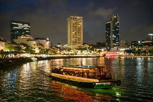 Tourist boat near the historic Boat Quay in Singapore river at dusk, Singapore by Martin Child