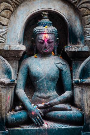 An inset stone Buddha statue at Swayambhunath temple. by Martin Edstrom