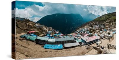 Panoramic view of Namche Bazaar with heavy clouds in the background. by Martin Edstrom