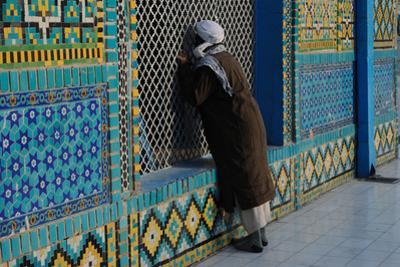 A Man Praying At the Shrine of Hazrat Ali, Or Blue Mosque
