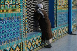 A Man Praying At the Shrine of Hazrat Ali, Or Blue Mosque by Martin Gray