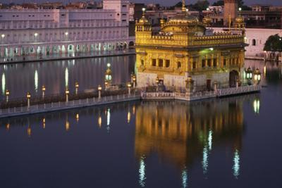 A night view of the Sikh Golden Temple and reflections. by Martin Gray
