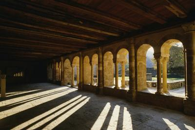 Cloister view of the Benedictine Abbey in Conques. by Martin Gray