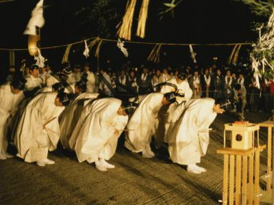 Shinto Priests Bow at the Kamiarizuku Festival