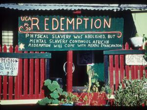 Sign on a Rastafarian Store by Martin Gray