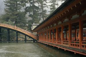 The Emperor's bridge at the Shinto Itsukushima shrine. by Martin Gray