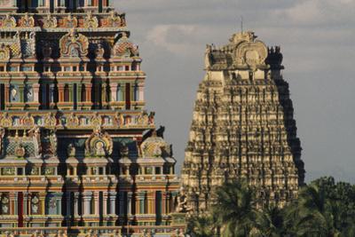 The towers of the Sri Ranganatha Vishnu Temple. by Martin Gray