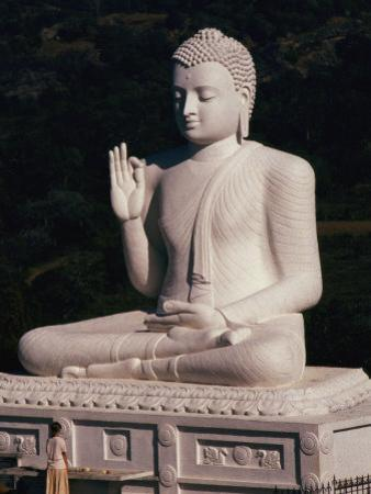 Visitor Prays at the Mihintale Buddha Statue