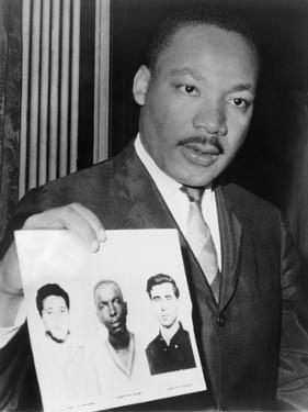 Martin Luther King Holding Photographs of Three Murdered Civil Rights Workers, 1964