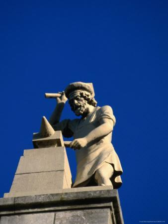 Figure of a Blacksmith on the Roof of the Rijksmuseum, Amsterdam, Netherlands
