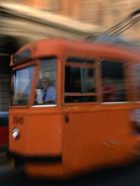 Orange Tram Moving, Naples, Italy by Martin Moos