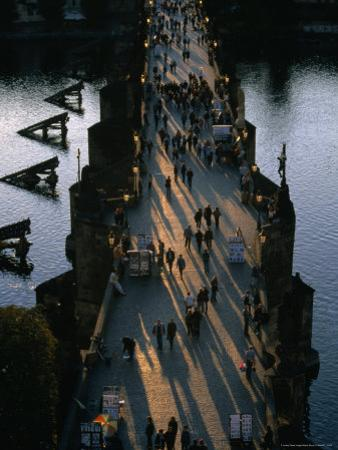 People Crossing Charles Bridge, Prague, Czech Republic