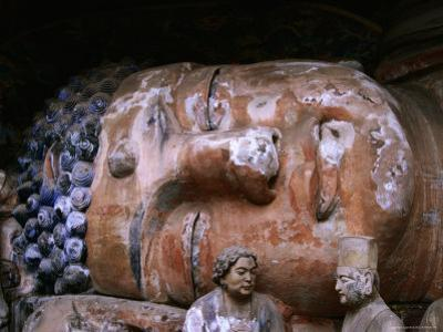 Reclining Buddha at Baoding Grottoes, Dazu, China by Martin Moos