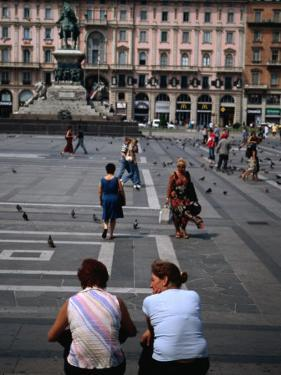 Two Women Chatting on Piazza Del Duomo, Milan, Italy by Martin Moos