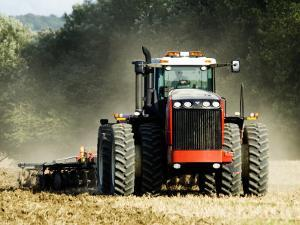 4 Wheel Drive Tractor Pulling a Disc Harrow, Cotswolds, England by Martin Page