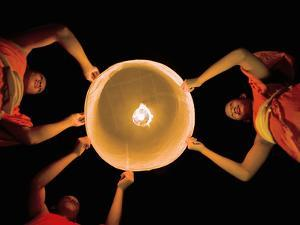 Buddhist Monks Launching a Khom Loy Lantern by Martin Puddy