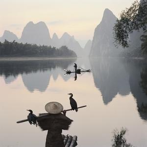 Cormorant fishermen in Li River by Martin Puddy