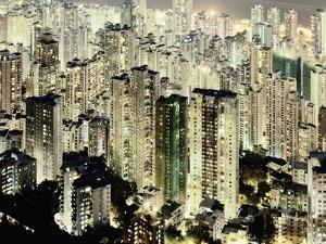 Hong Kong skyscrapers and apartment blocks at night by Martin Puddy