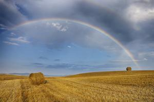 Rainbow over Harvested Wheat Field, Summer. by Martin Ruegner